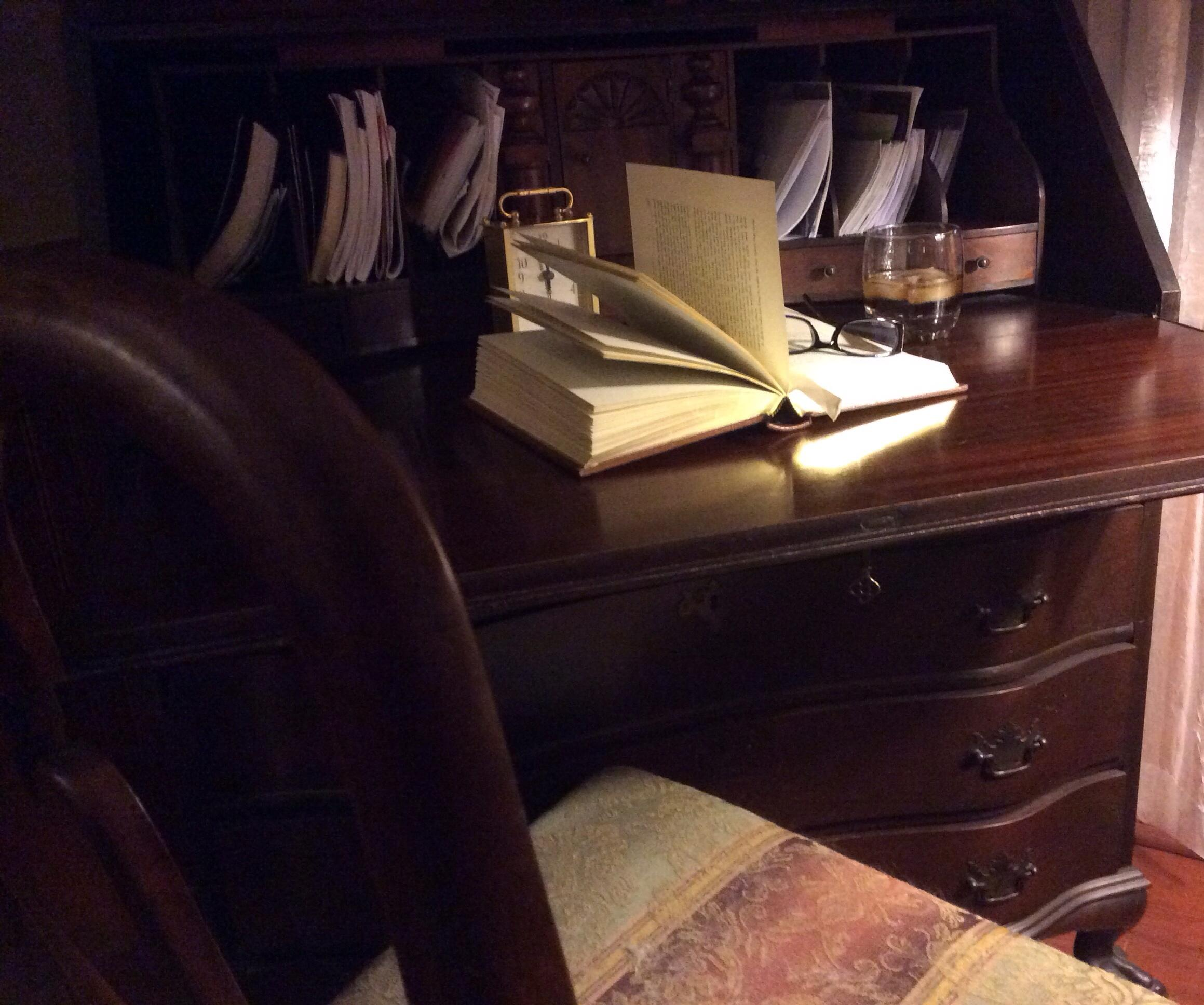 book on desk with glasses
