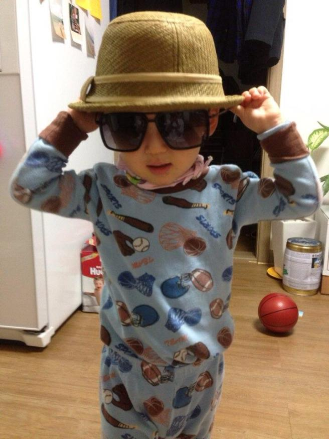 child in hat and glasses