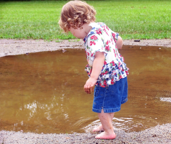 little-girl-in-puddle